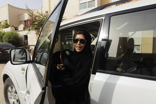 Female driver Azza Al Shmasani alights from her car after driving in defiance of the ban in Riyadh, June 2011. REUTERS/Fahad Shadeed