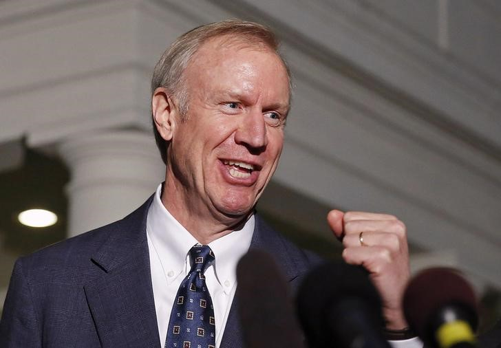 FILE PHOTO - Bruce Rauner talks to the media at the White House in Washington December 5, 2014. REUTERS/Larry Downing/File Photo