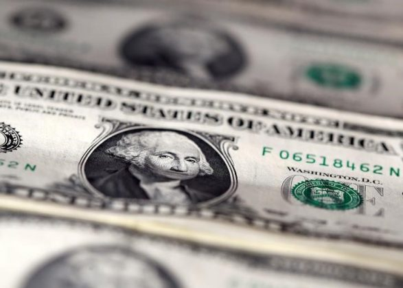 FILE PHOTO: U.S. dollar notes are seen in this November 7, 2016 picture illustration. REUTERS/Dado Ruvic/Illustration/File Photo