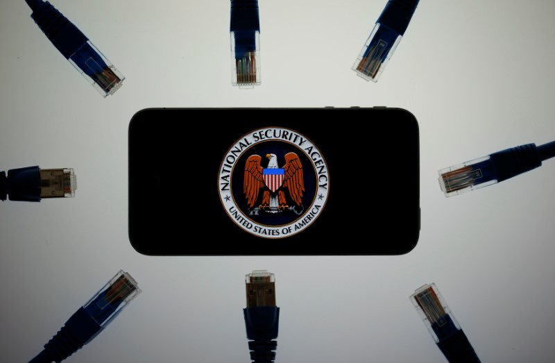 FILE PHOTO: An illustration picture shows the logo of the U.S. National Security Agency on the display of an iPhone, June 7, 2013. REUTERS/Pawel Kopczynski/Illustration/File photo