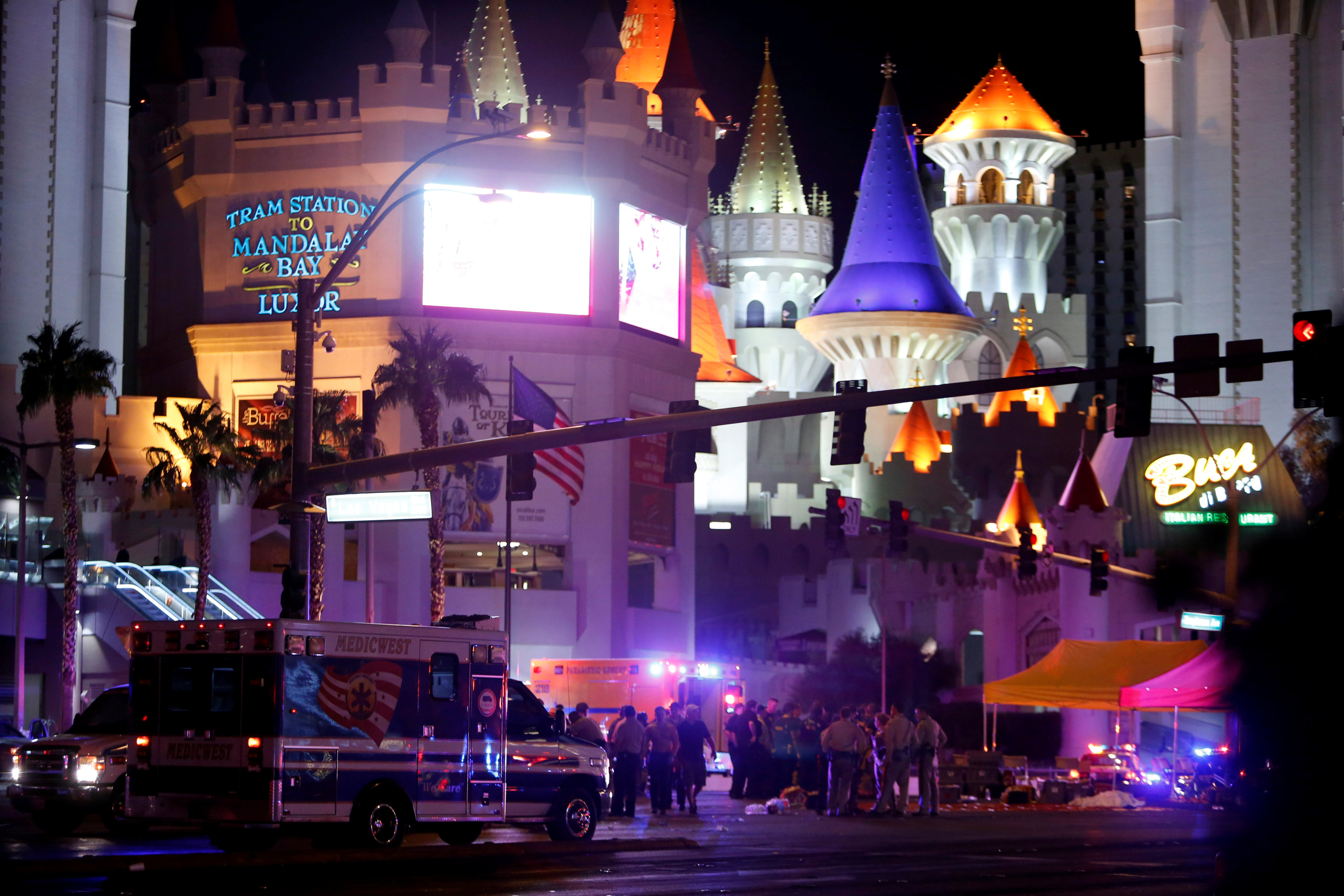 Las Vegas Metro Police and medical workers stage in the intersection of Tropicana Avenue and Las Vegas Boulevard South after a mass shooting at a music festival on the Las Vegas Strip in Las Vegas, Nevada, U.S. October 1, 2017.