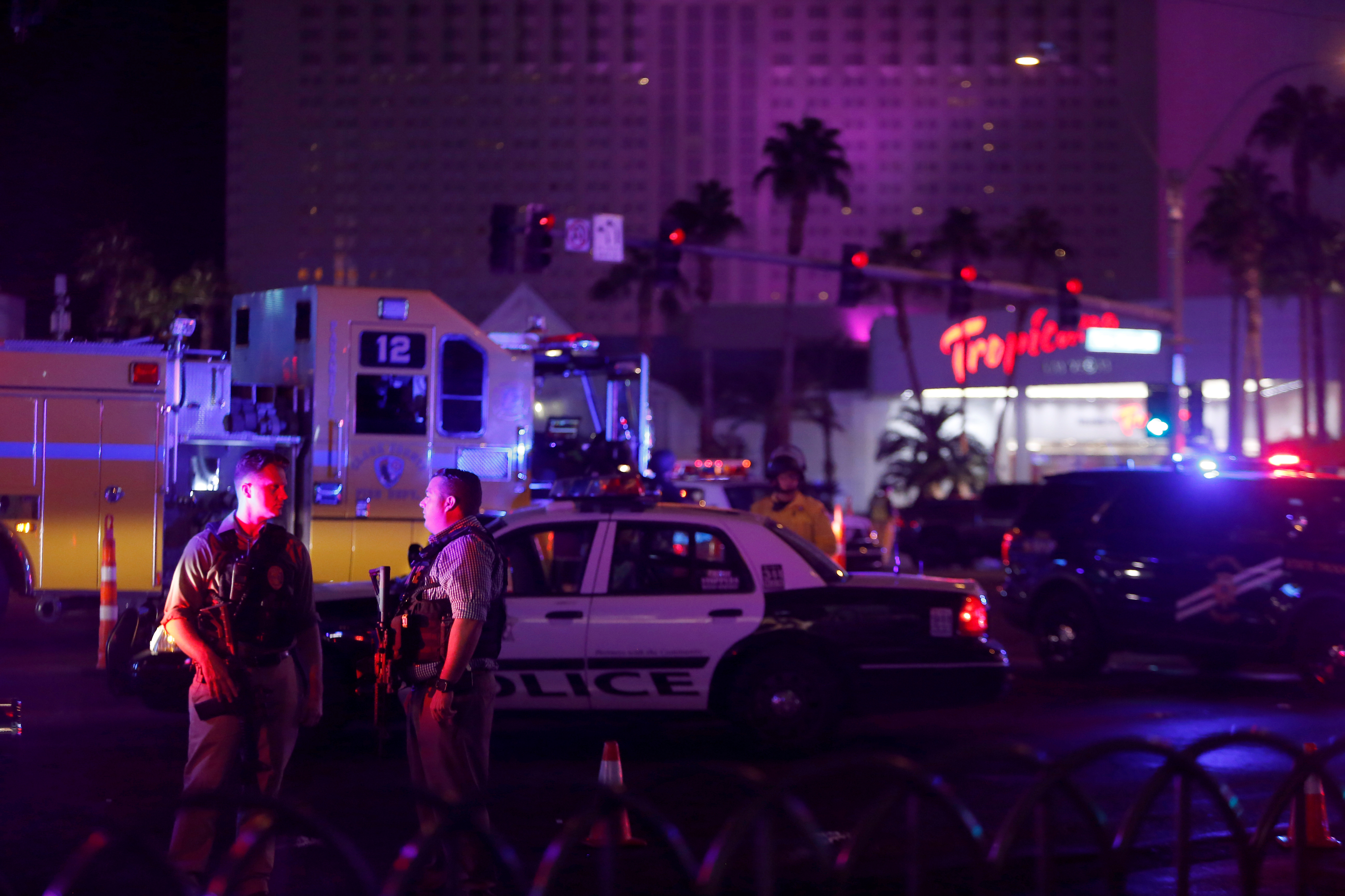 Las Vegas Metro Police officers confer near a staging area in the intersection of Tropicana Avenue and Las Vegas Boulevard South.