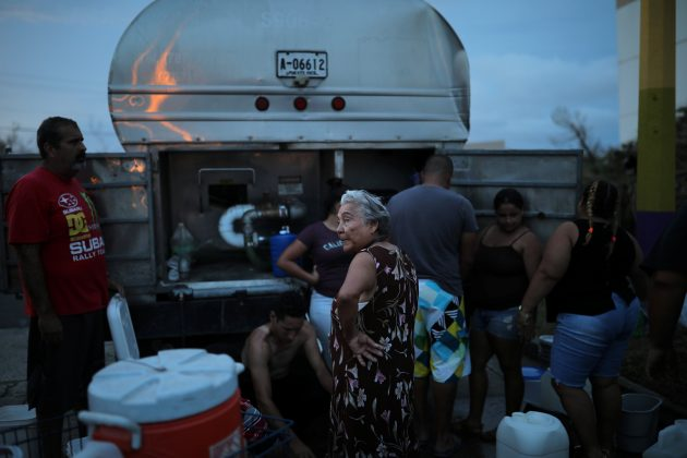 Local residents wait in line during a water distribution in Bayamon following damages caused by Hurricane Maria in Las Piedras, Puerto Rico, October 1, 2017