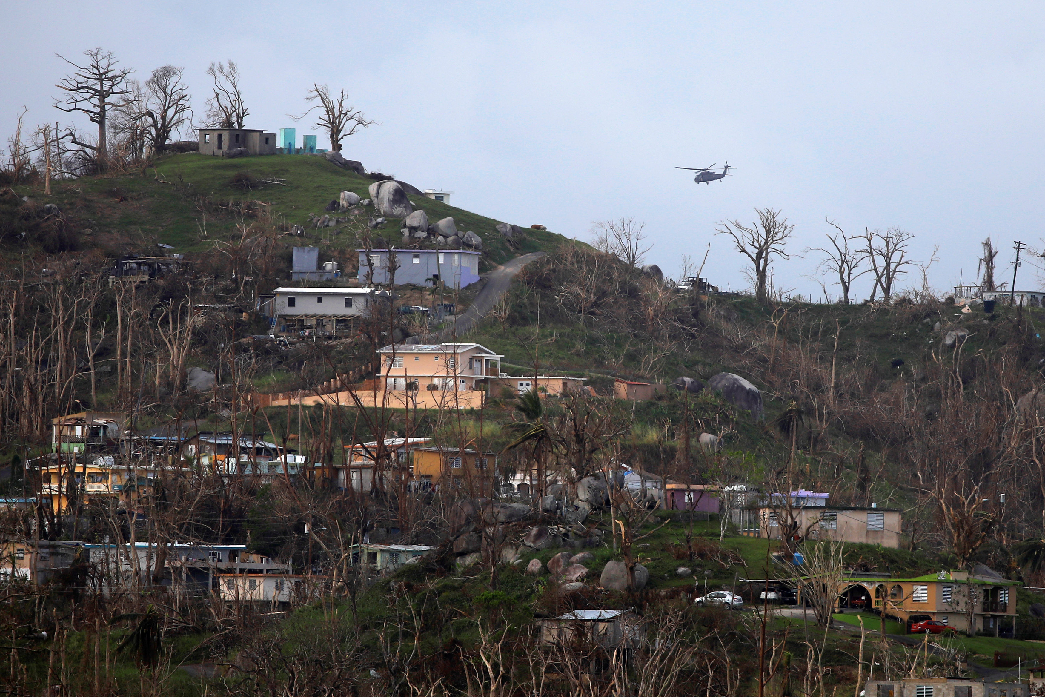 A military helicopter flight over a residential area following damages caused by Hurricane Maria near Caguas, Puerto Rico, October 1, 2017