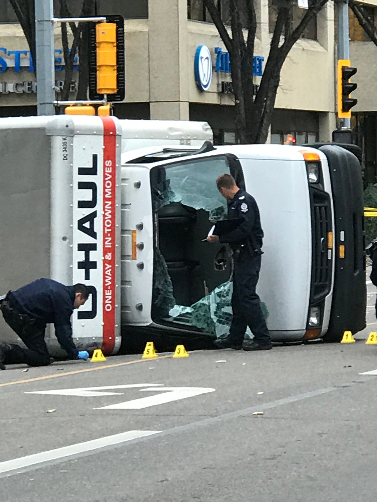 Edmonton Police investigate at the scene where a man hit pedestrians then flipped the U-Haul truck he was driving, pictured at the intersection at 107 Street and 100th Avenue in front of the Matrix Hotel in Edmonton, Alberta, Canada October 1, 2017.