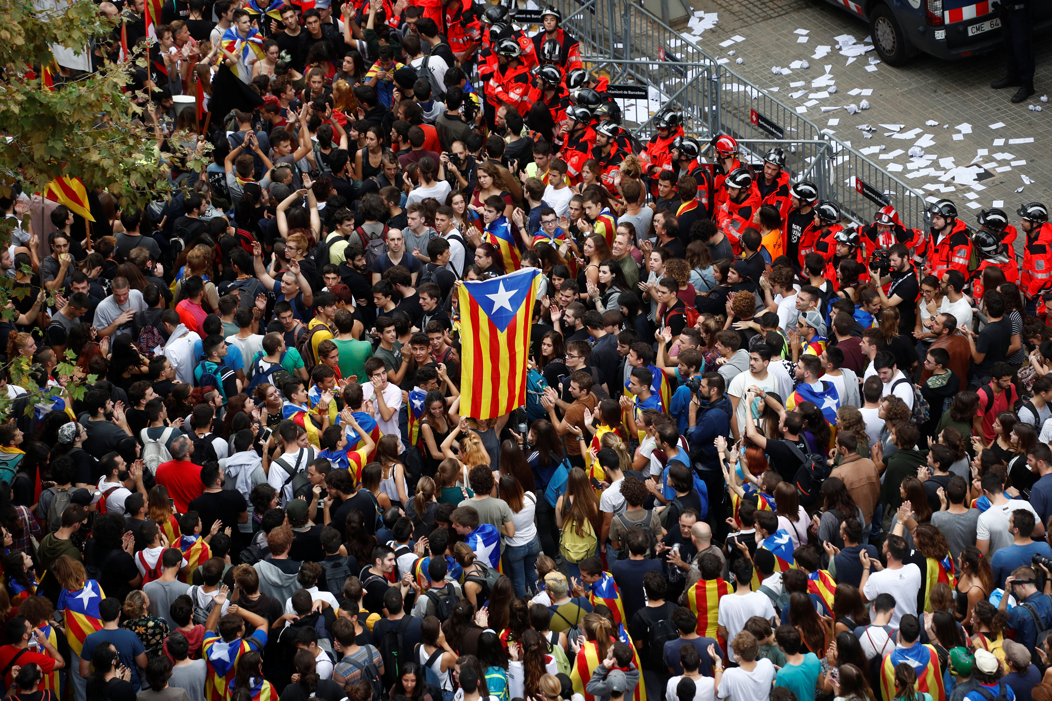 Tens of thousands of Catalans take to streets to protest police action