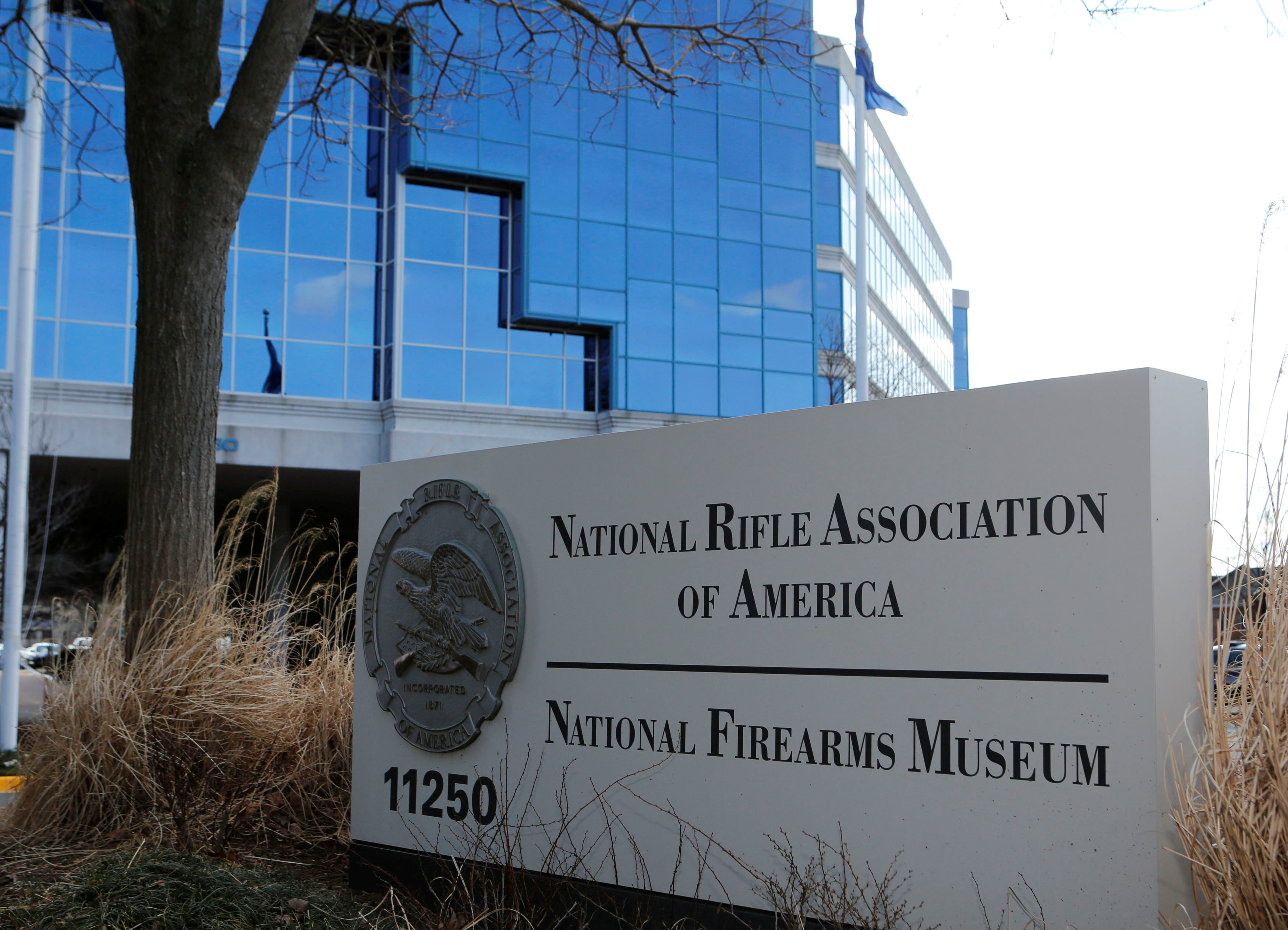 FILE PHOTO: A sign of the National Rifle Association (NRA) is seen in front of their headquarters in Fairfax, Virginia, U.S. on March 14, 2013. REUTERS/Larry Downing/File Photo