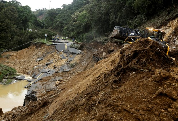 Heavy machinery is used to remove mud from a highway that connects with the south of the country collapsed by Storm Nate in Casa Mata, Costa Rica October 6, 2017. REUTERS/Juan Carlos Ulate