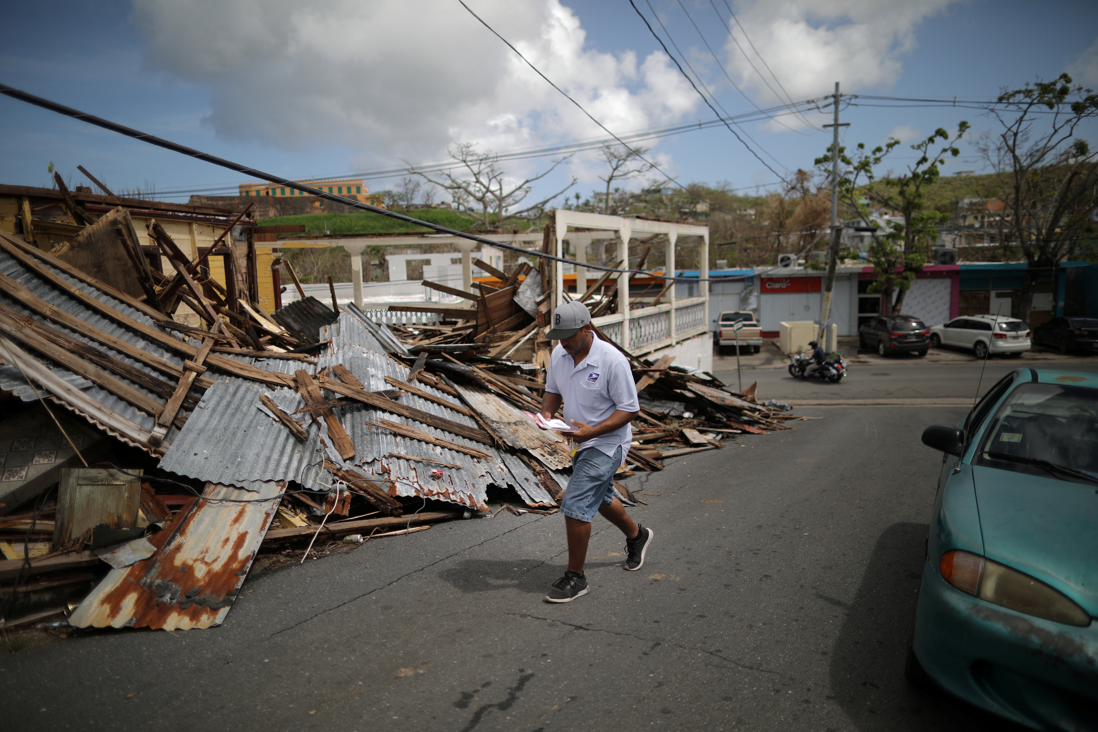 Luis Menendez, a mail man for the U.S. Postal Service, delivers mail at an area affected by Hurricane Maria in the island of Vieques, Puerto Rico, October 7, 2017