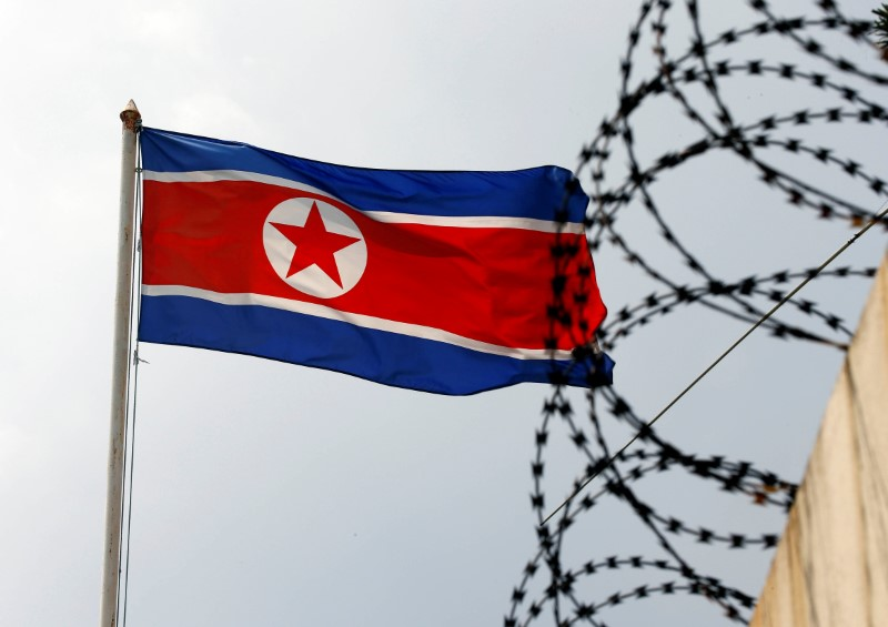 The North Korea flag flutters next to concertina wire at the North Korean embassy in Kuala Lumpur, Malaysia March 9, 2017. REUTERS/Edgar Su