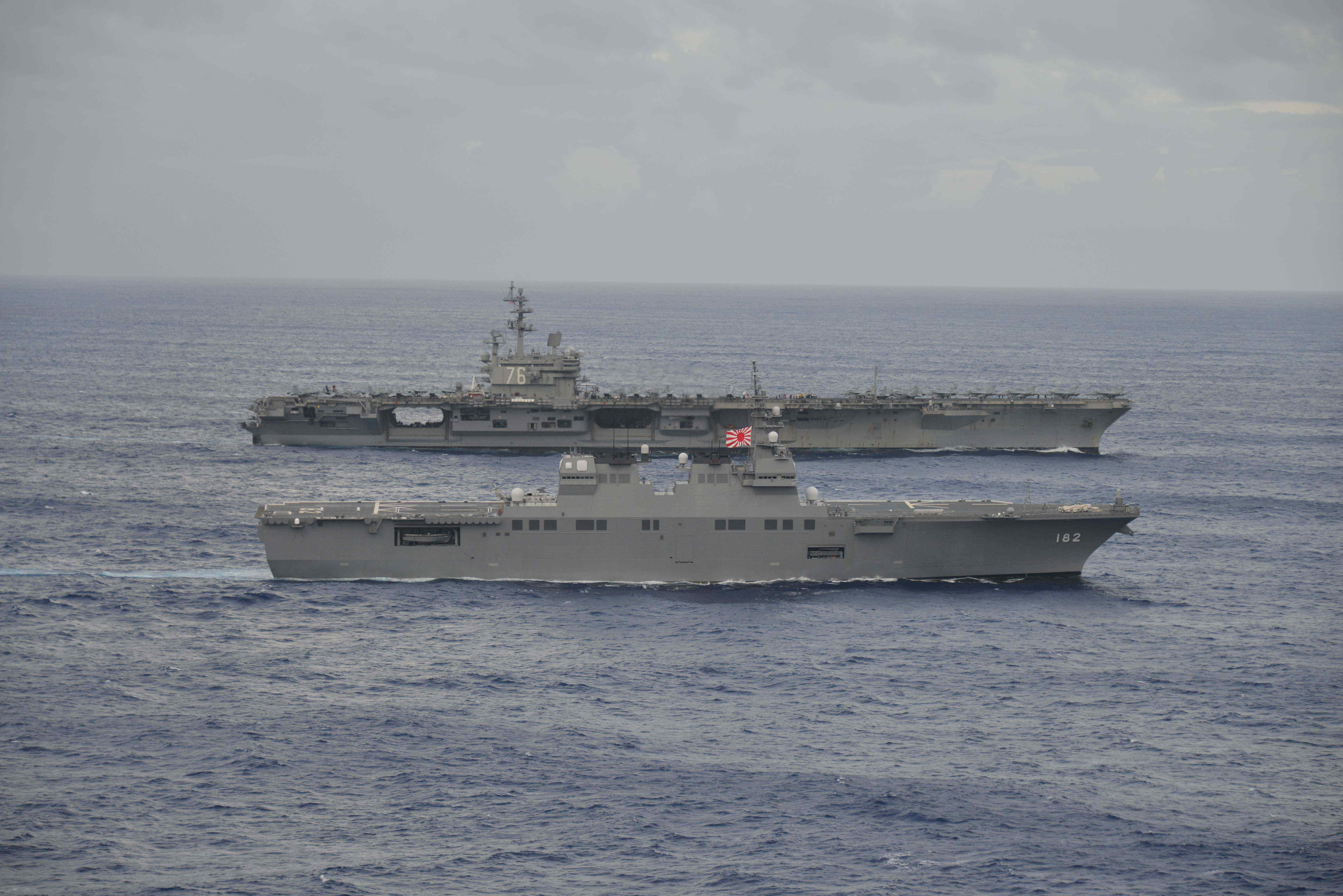 USS Ronald Reagan (rear), a Nimitz-class nuclear-powered supercarrier, sails side-by-side with Japan Maritime Self-Defense Force's Hyuga-class helicopter destroyer Ise (DDH-182) during their joint military drill in the sea off Japan, in this photo released taken by Japan Maritime Self-Defense Force on September 14, 2017 and released on September 22, 2017. Picture taken September 14, 2017. Japan Maritime Self-Defense Force/HANDOUT via REUTERS
