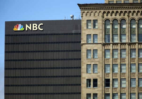 The NBC logo is picture atop their office building in San Diego, California September 1, 2015. REUTERS/Mike Blake - GF10000189520