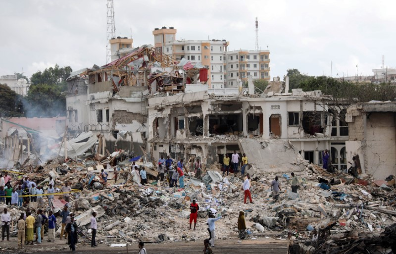 Somali government forces and civilians gather at the scene of an explosion in KM4 street in the Hodan district of Mogadishu, Somalia October 15,