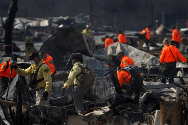 Search and Rescue teams search for two missing people amongst ruins at Journey's End Mobile Home Park destroyed by the Tubbs Fire in Santa Rosa.