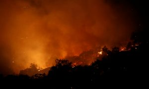 California wildfire evacuees allowed home as crews search for bodies