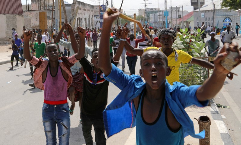 Protesters chant slogans while demonstrating against last weekend's explosion in KM4 street in the Hodan district in Mogadishu, Somalia October 18, 2017. REUTERS/Feisal Omar
