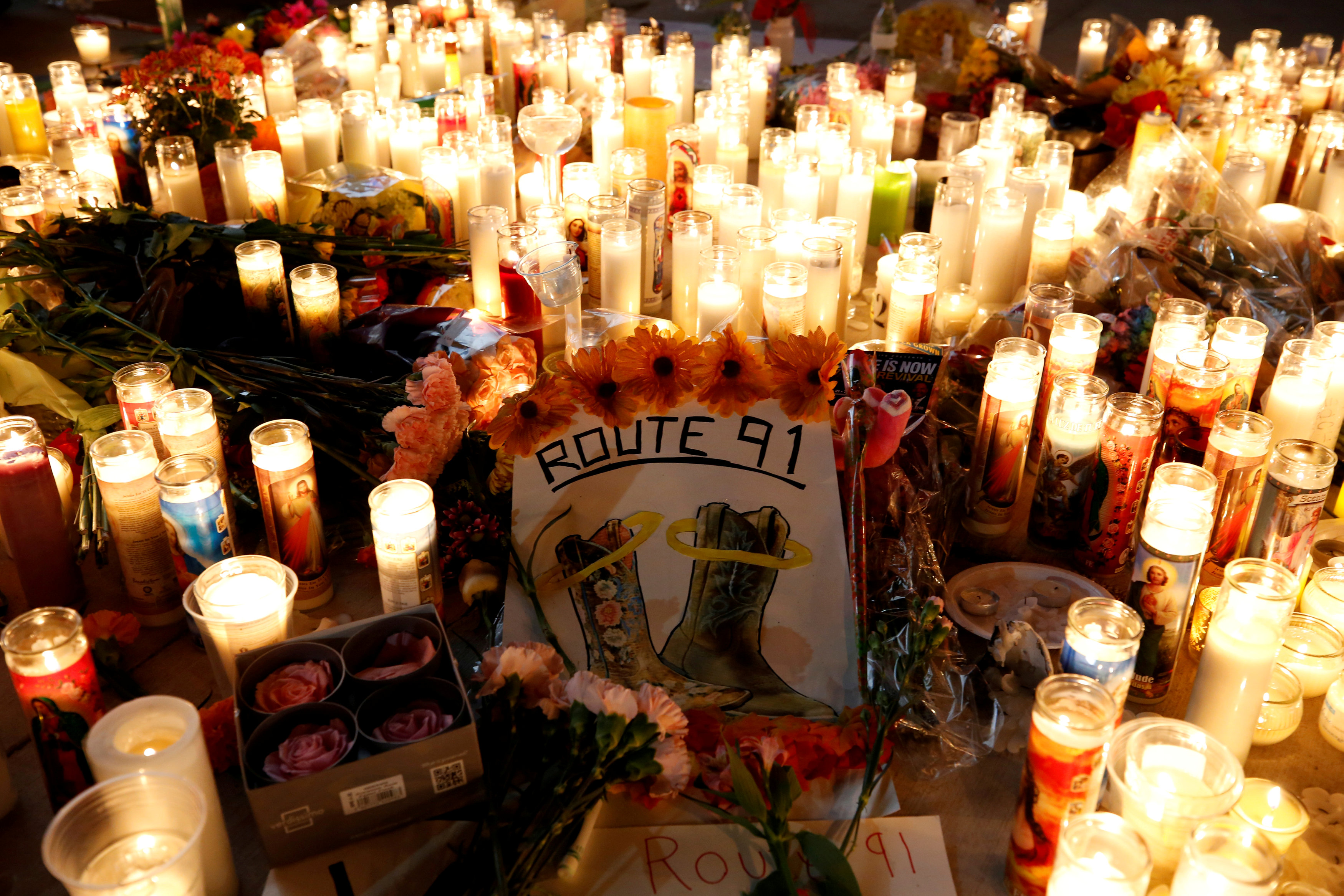 FILE PHOTO: A candlelight vigil is pictured on the Las Vegas strip following a mass shooting at the Route 91 Harvest Country Music Festival in Las Vegas, Nevada, U.S., October 2, 2017. Picture taken October 2, 2017. REUTERS/Chris Wattie/File Photo