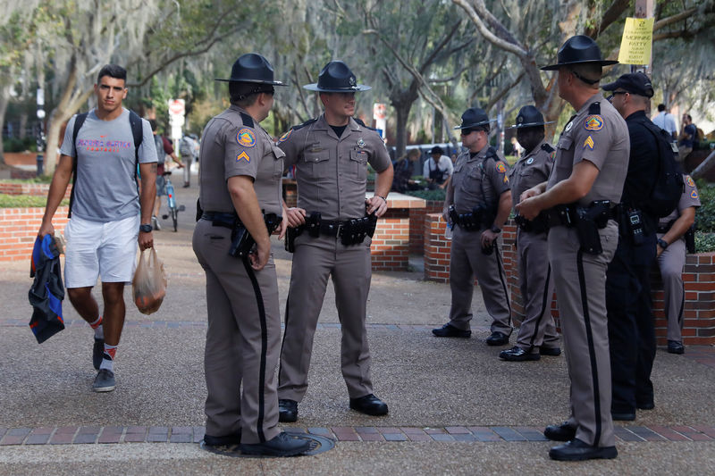Florida Highway Patrol officers stand guard the day before a speech by Richard Spencer, an avowed white nationalist and spokesperson for the so-called alt-right movement, on the campus of the University of Florida in Gainesville. REUTERS/Shannon Stapleton