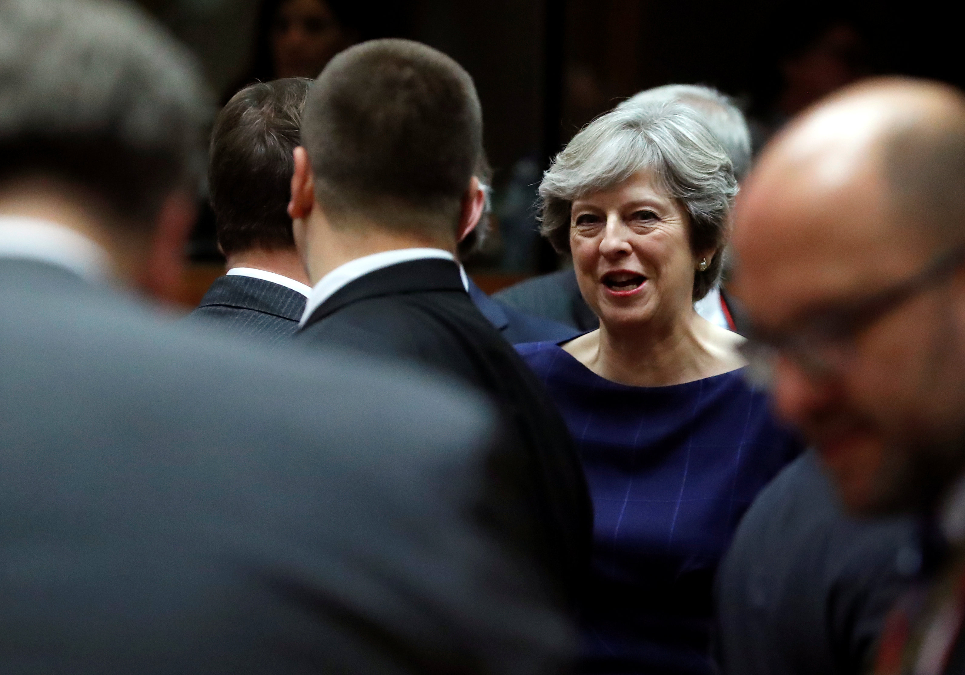 Britain's Prime Minister Theresa May (C) attends the EU summit in Brussels, Belgium October 19, 2017. REUTERS/Yves Herman