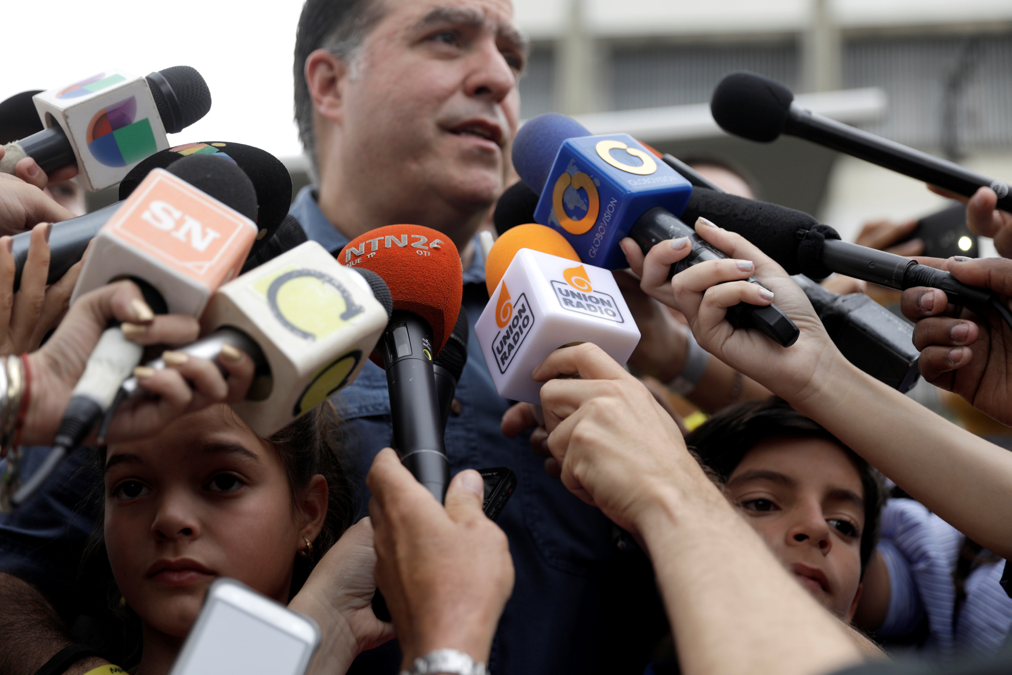 Leaders of Venezuela's bruised opposition to travel abroad to denounce 'voting fraud'