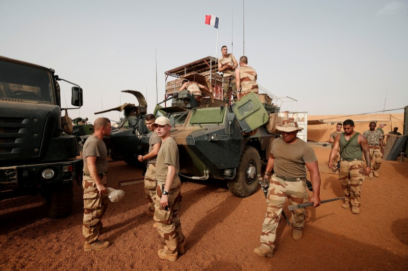 French soldiers prepare their armoured vehicles at the Relay Desert Platform Camp (PfDR) in Ansongo, Mali, October 15, 2017, during the regional anti-insurgent Operation Barkhane. REUTERS/Benoit Tessier