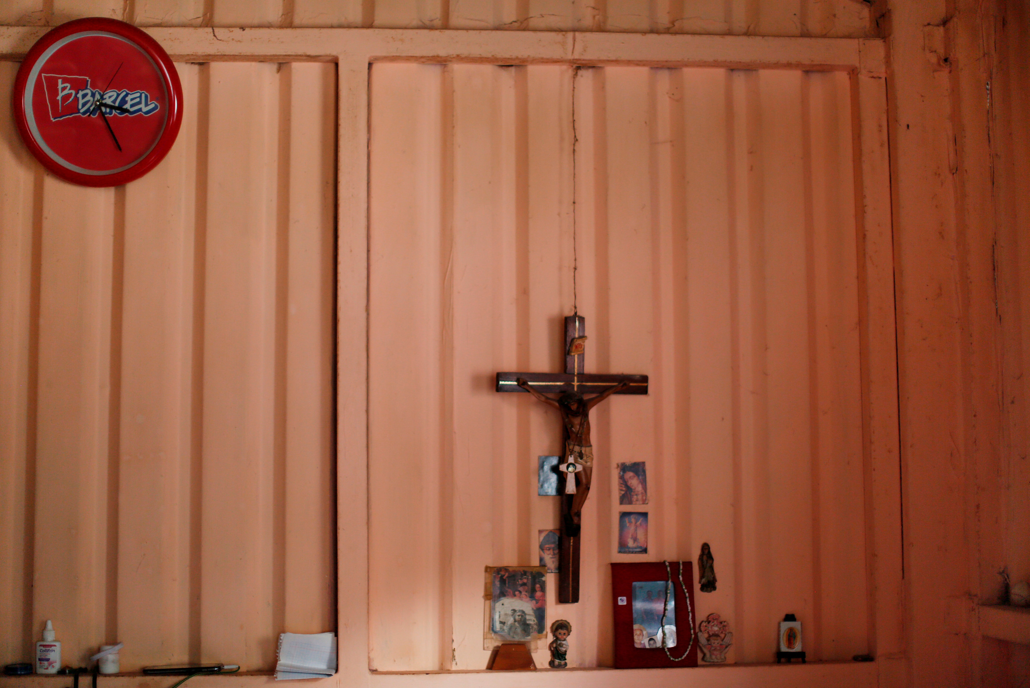 A cross is displayed at the home of Martha Mejia at the camp known as No.3, in Mexico City, Mexico, October 17, 2017. The camp was founded in 1985 after an earthquake, which killed around 5,000 people. Mejia lost her home in the 1985 earthquake. REUTERS/Carlos Jasso