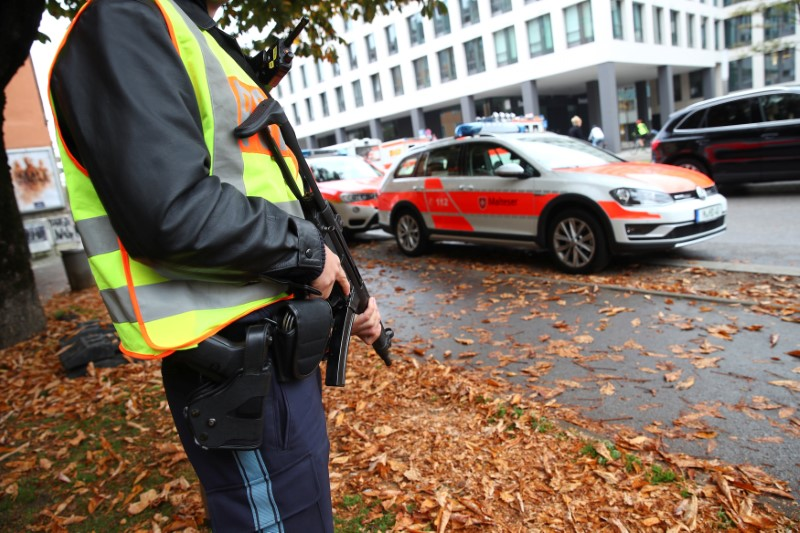 A German police officer guards the site where earlier a man injured several people in a knife attack in Munich, Germany, October 21, 2017. REUTERS/Michael Dalder