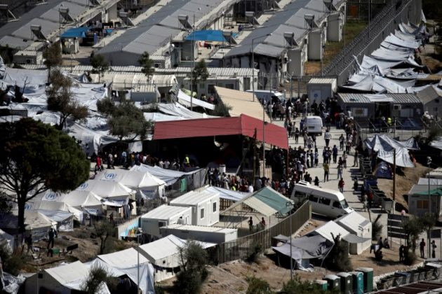 : Refugees and migrants line up for food distribution at the Moria migrant camp on the island of Lesbos, Greece October 6, 2016.