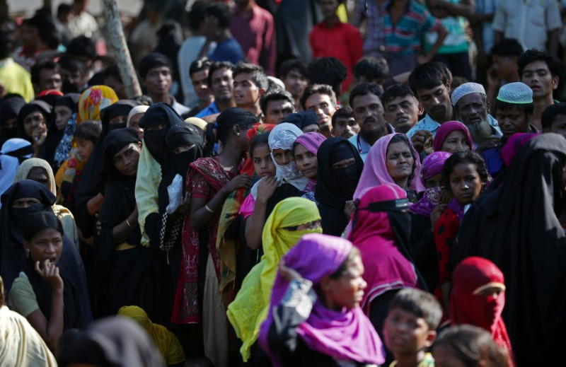 Rohingya refugees line up to receive humanitarian aid in Kutupalong refugees camp near Cox's Bazar, Bangladesh, October 23, 2017.