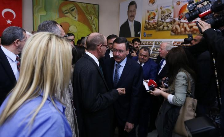 Turkey's ruling AK Party (AKP) mayoral candidate and current Ankara Mayor Melih Gokcek (C) attends an event as part of his election campaign in Ankara March 18, 2014. REUTERS/Umit Bektas