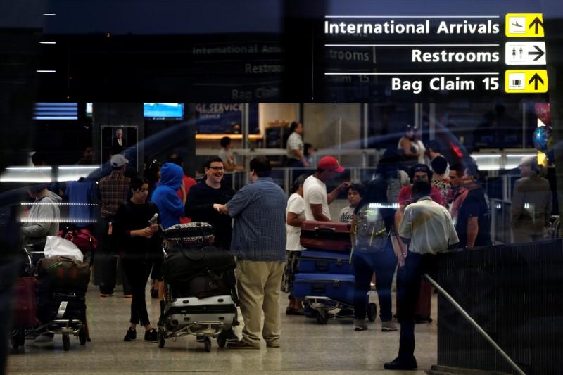 International passengers arrive at Washington Dulles International Airport after clearing immigration and customs in Dulles, Virginia, U.S. September 24, 2017. REUTERS/James Lawler Duggan