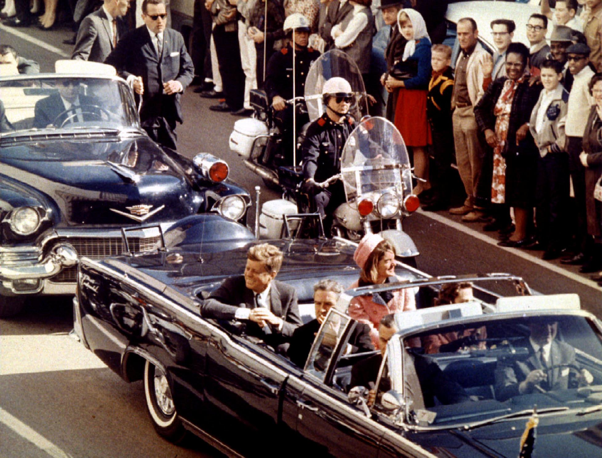 Trump releases some JFK files, blocks others under pressure