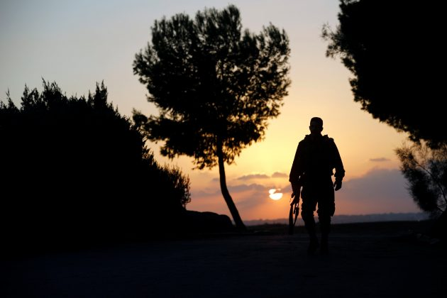 An Israeli soldier walks near the border line, between Israel and the Gaza Strip, in Israel October 30, 2017.