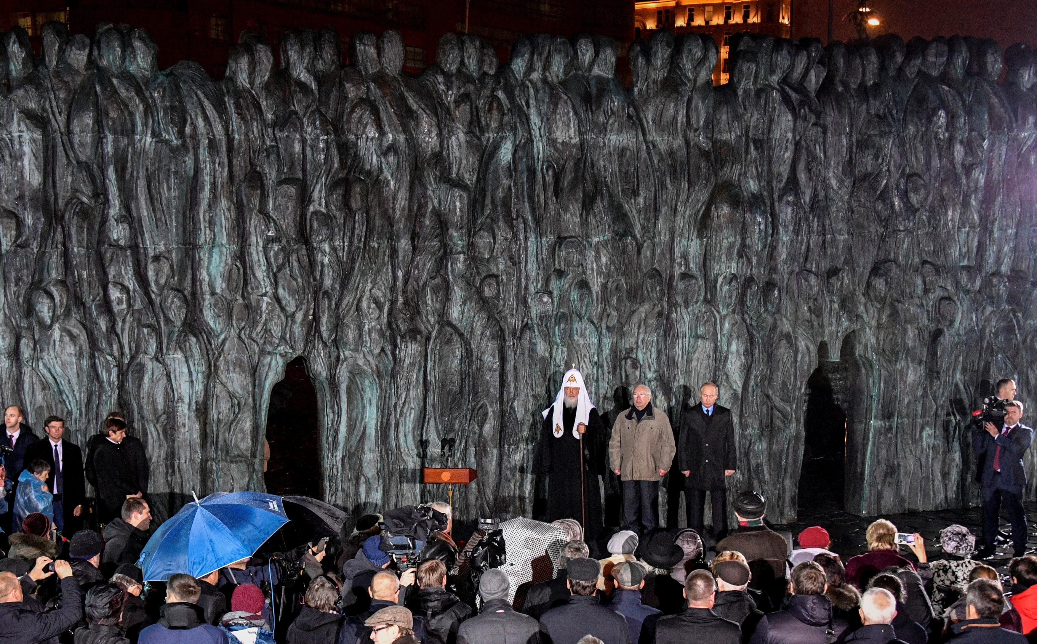 """Russian President Vladimir Putin with Patriarch Kirill, the head of the Russian Orthodox Church, and former Human Rights Ombudsman Vladimir Lukin attend a ceremony unveiling the country's first national memorial to victims of Soviet-era political repressions called """"The Wall of Grief"""" in downtown Moscow, Russia October 30, 2017. REUTERS/Alexander"""