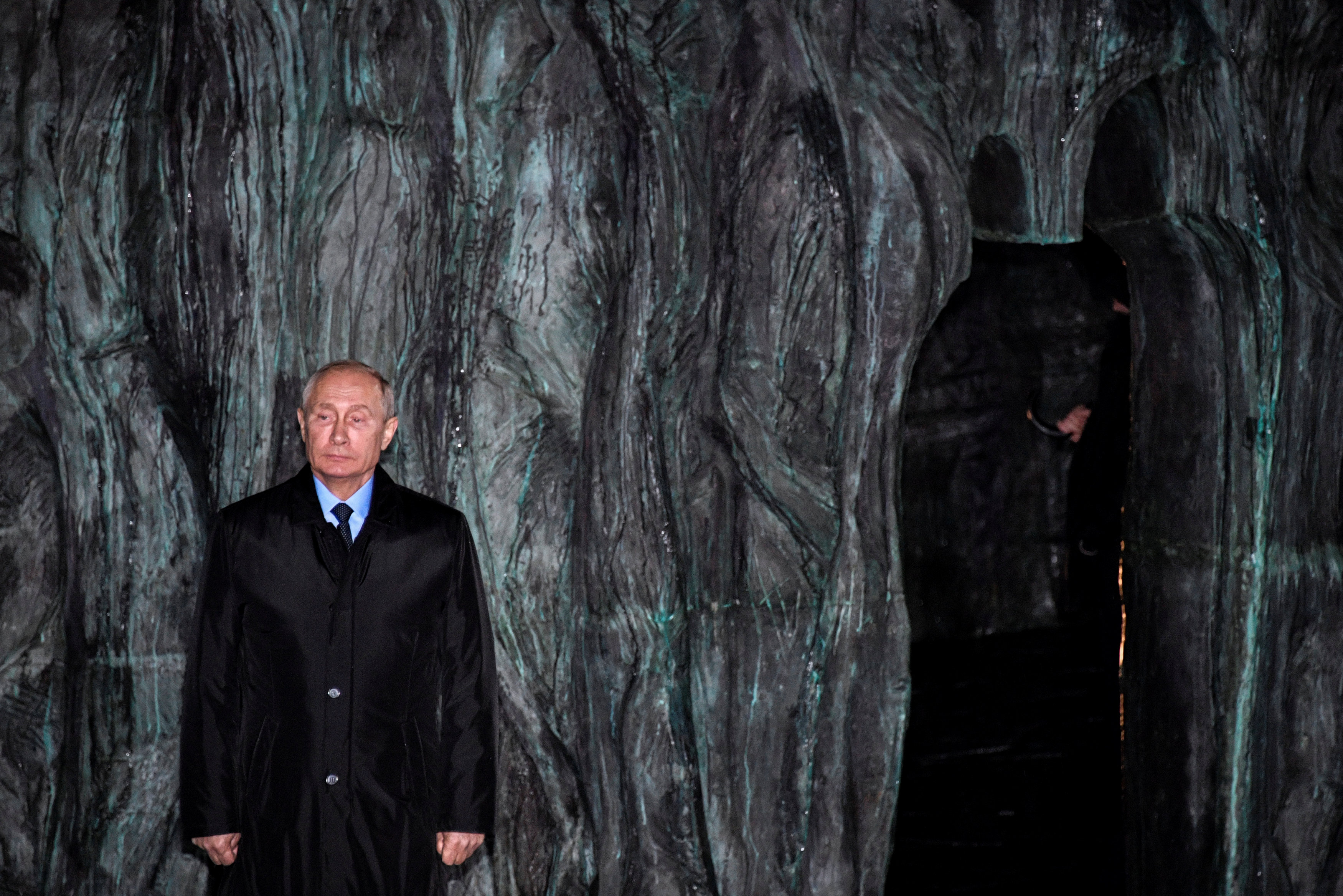 """Russian President Vladimir Putin attends a ceremony unveiling the country's first national memorial to victims of Soviet-era political repressions called """"The Wall of Grief"""" in Moscow, Russia October 30, 2017."""