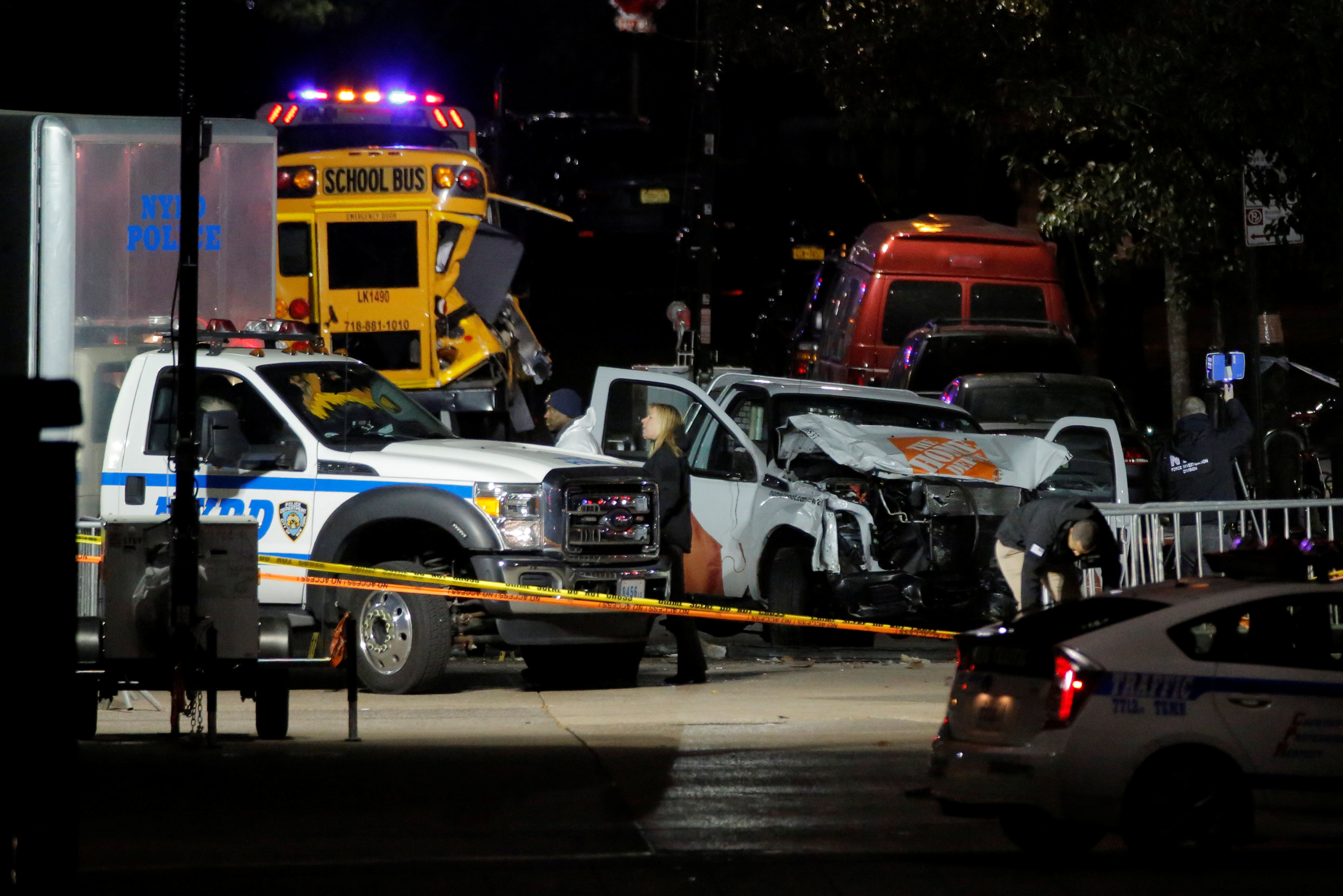 Police investigate a pickup truck used in an attack on the West Side Highway in Manhattan, New York, U.S.,