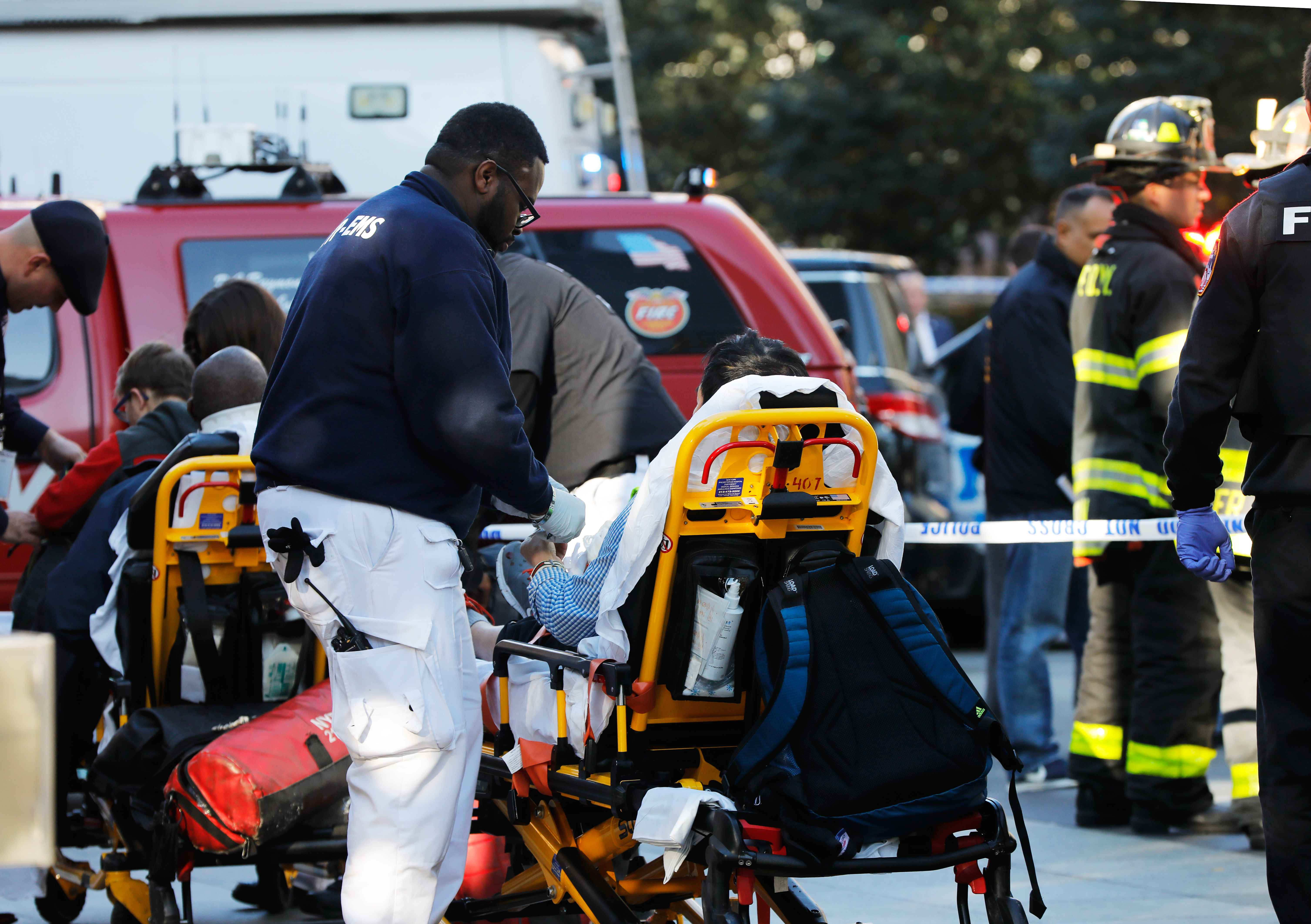 First responders tend to a victim after a shooting incident in New York City