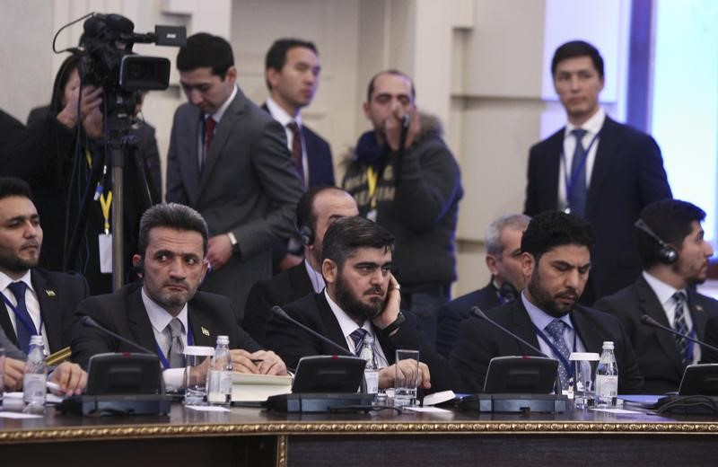 Mohammad Alloush (C), the head of the Syrian opposition delegation, attends Syria peace talks in Astana, Kazakhstan