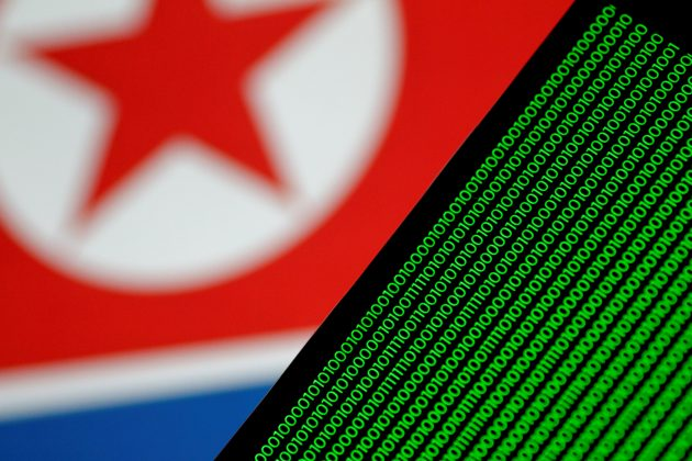Binary code is seen on a screen against a North Korean flag in this illustration photo November 1, 2017.