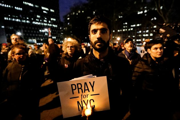 People gather for a candlelight vigil for victims of the pickup truck attack at Foley Square in New York City, U.S., November 1, 2017
