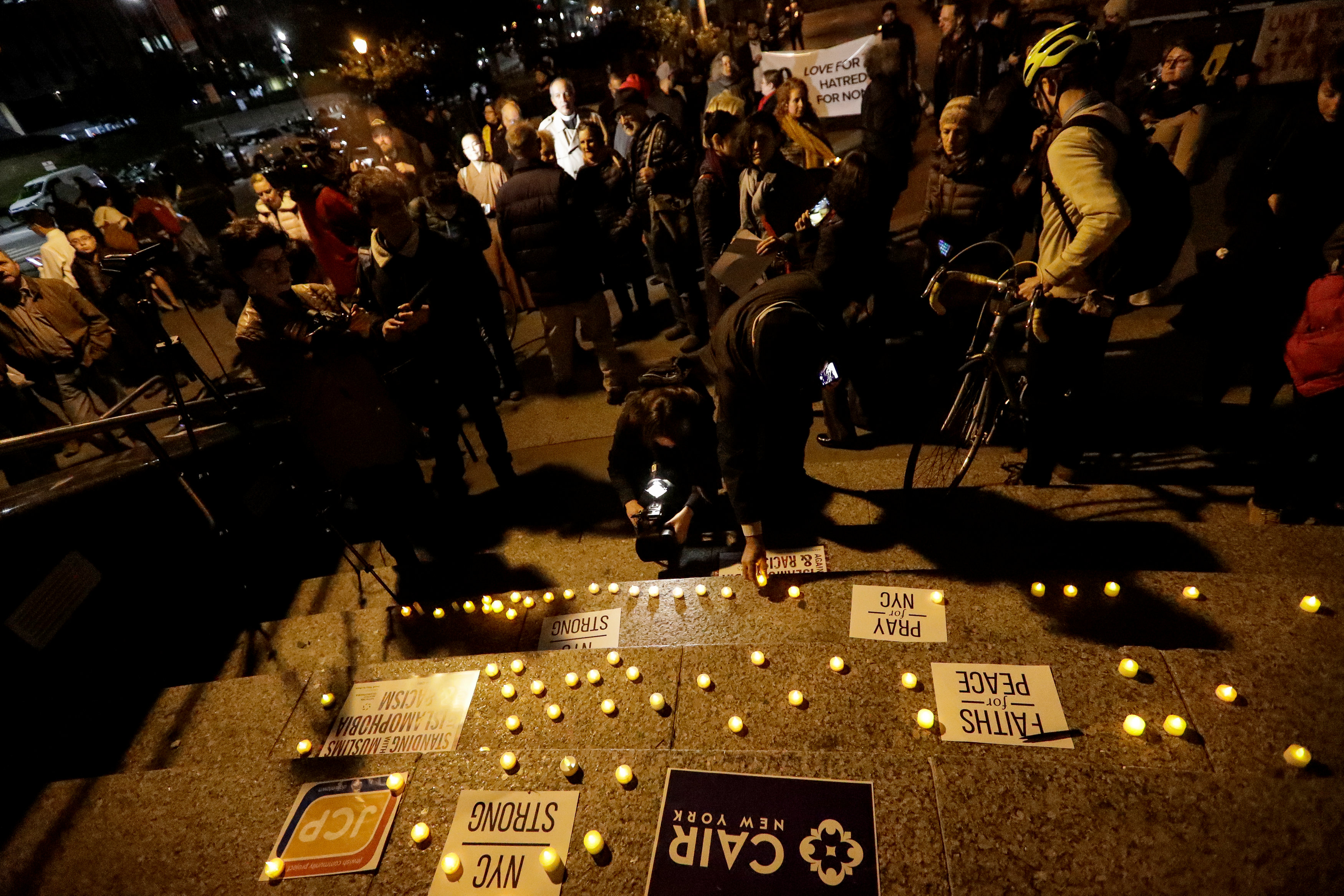 Candles are seen during a vigil for victims of the pickup truck attack at Foley Square in New York City, U.S., November 1, 2017