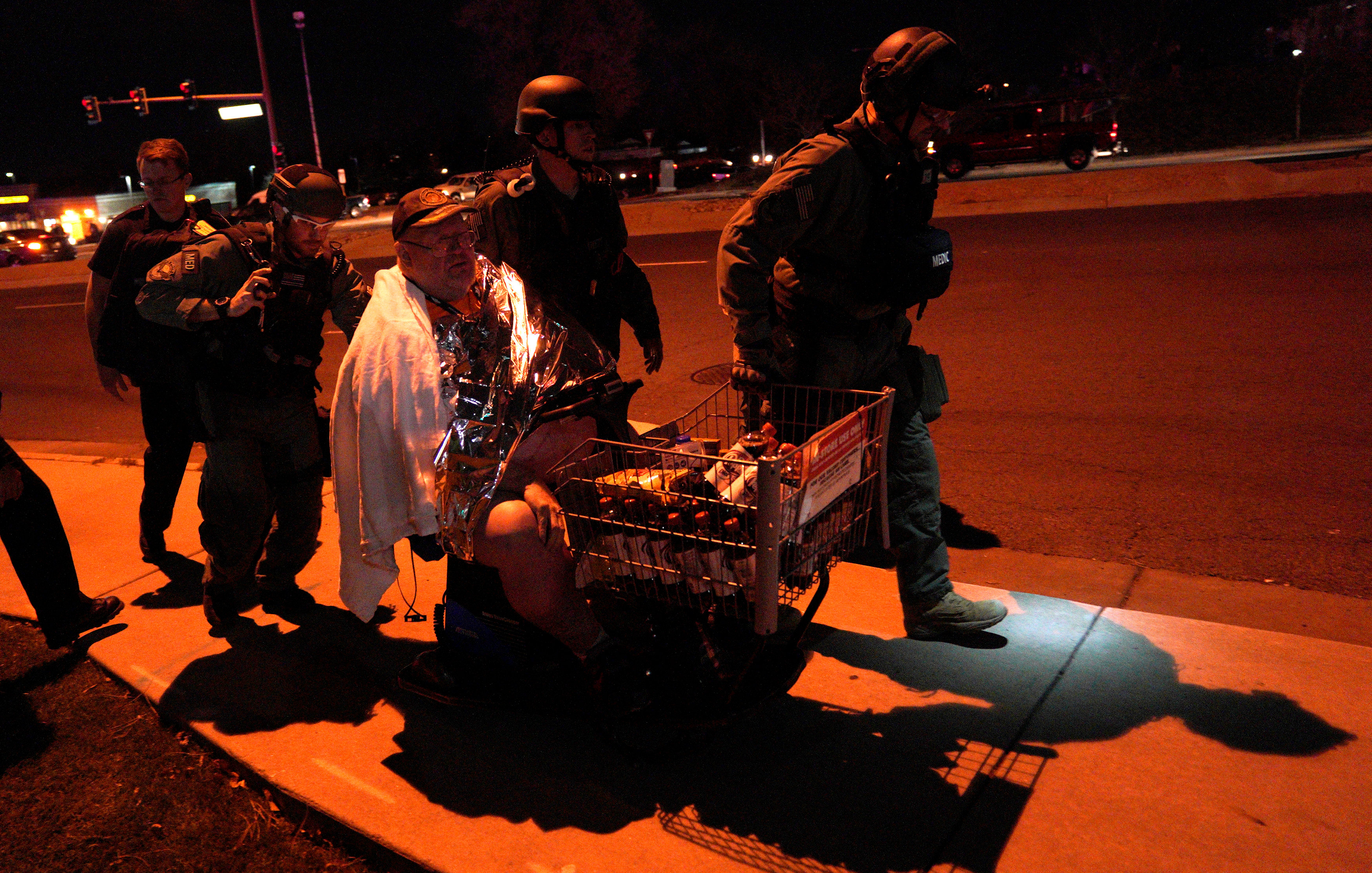 Patrick Carnes is evacuated in a Walmart cart by SWAT medics from the scene of a shooting at a Walmart where Carnes was shopping in Thornton, Colorado.