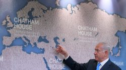 Israel's Prime Minister Benjamin Netanyahu gestures towards a world map as he attends a question and answer event on Israel's foreign policy at Chatham House in London, Britain, November 3, 2017.