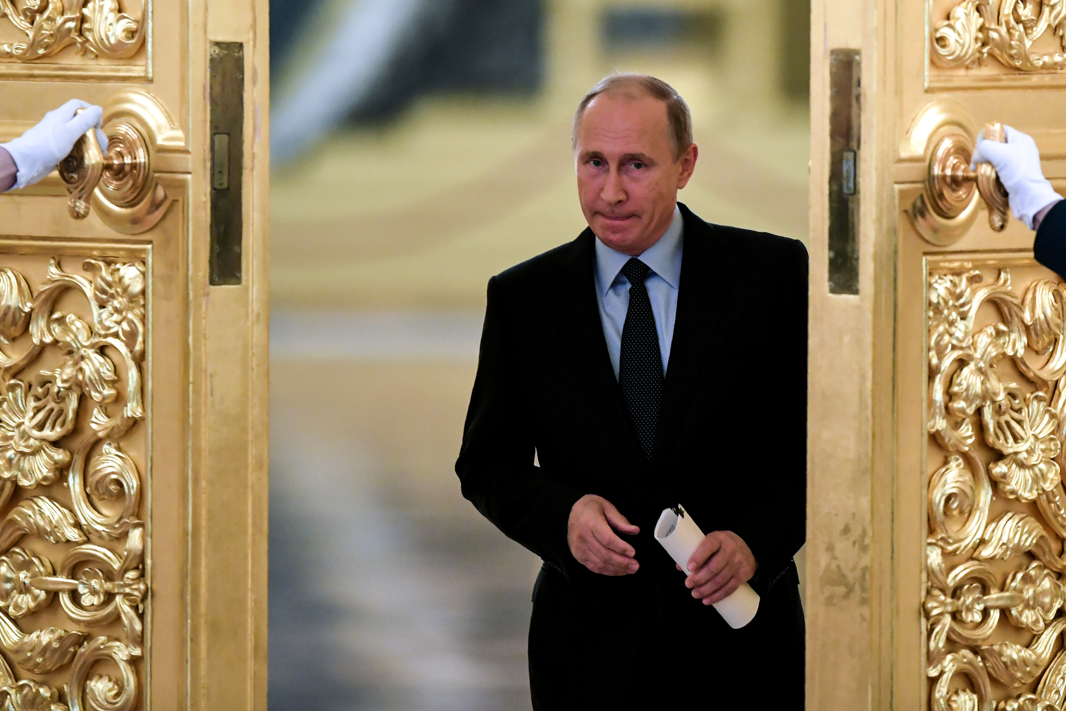 Russian President Vladimir Putin enters a hall to meet with members of the Presidential Council for Civil Society and Human Rights at the Kremlin in Moscow, Russia October 30, 2017