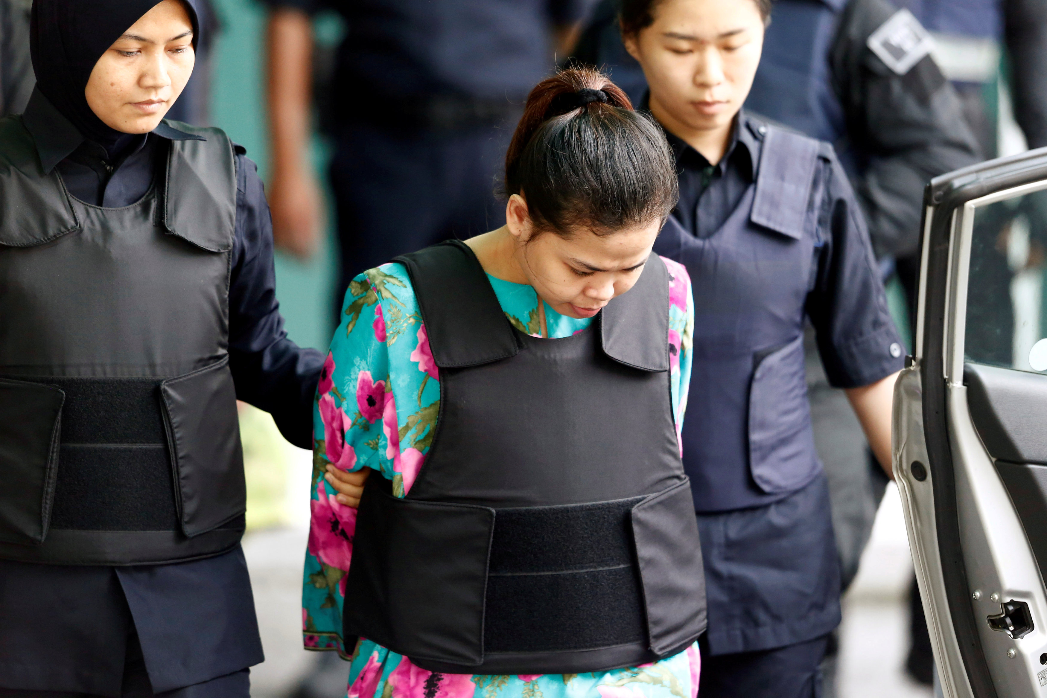 Indonesian Siti Aisyah who is on trial for the killing of Kim Jong Nam, the estranged half-brother of North Korea's leader, is escorted as she leaves at the Department of Chemistry in Petaling Jaya, near Kuala Lumpur, Malaysia