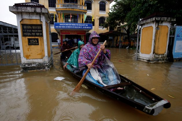Officials sail a boat out of a submerged local government building after typhoon Damrey hits Vietnam in Hue city, Vietnam November 5, 2017.