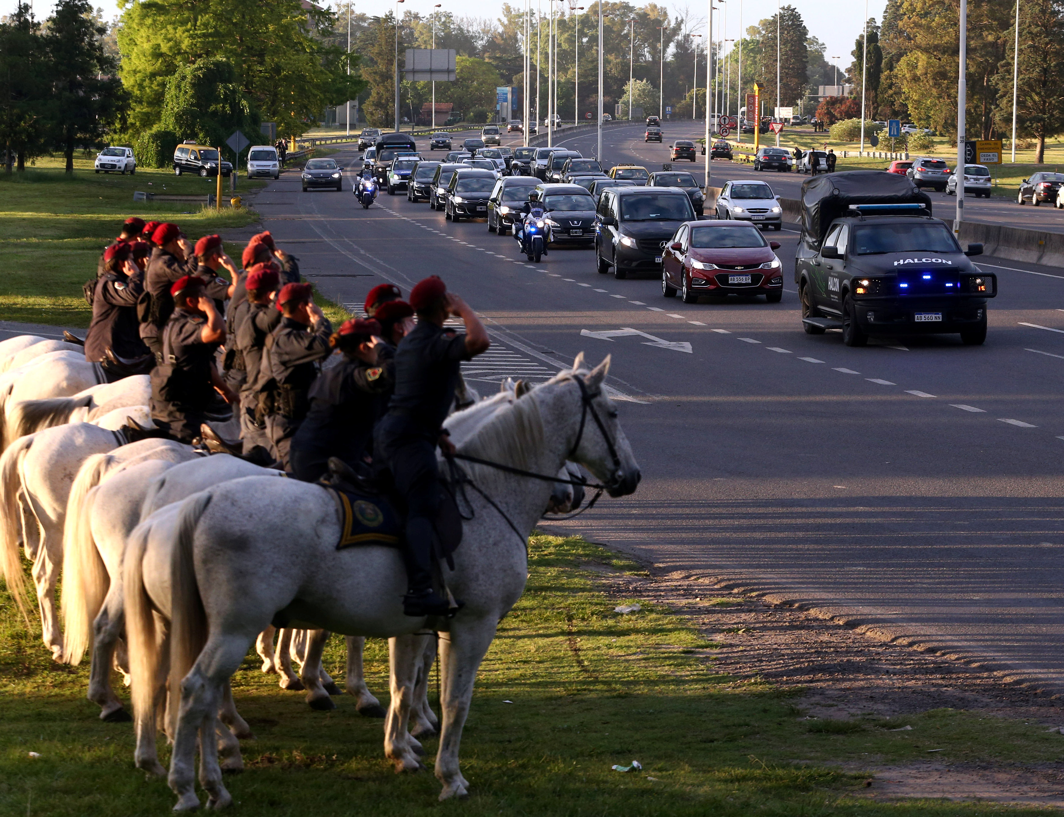 The funeral motorcade of the five Argentine citizens who were killed in the truck attack in New York on October 31 passes by as mounted policemen salute in Buenos Aires, Argentina November 6, 2017.