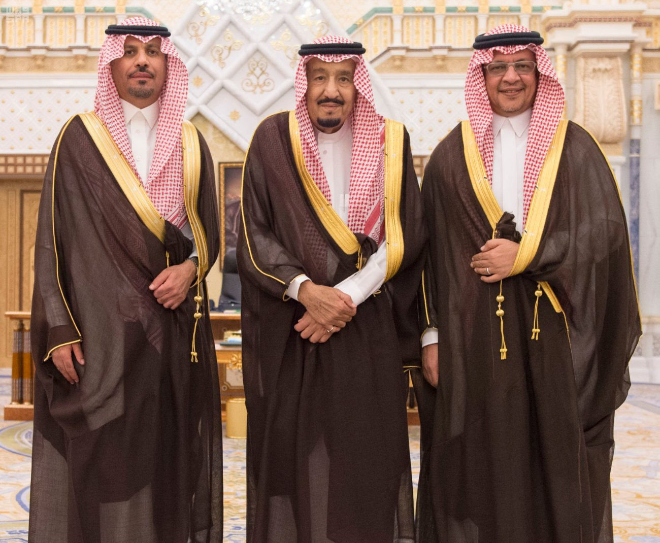 Saudi King Salman bin Abdulaziz Al Saud poses for a photo with National Guard Minister Khaled bin Ayyaf and Economy Minister Mohammed al-Tuwaijri during a swearing-in ceremony in Riyadh, Saudi Arabia, November 6, 2017. Saudi Press