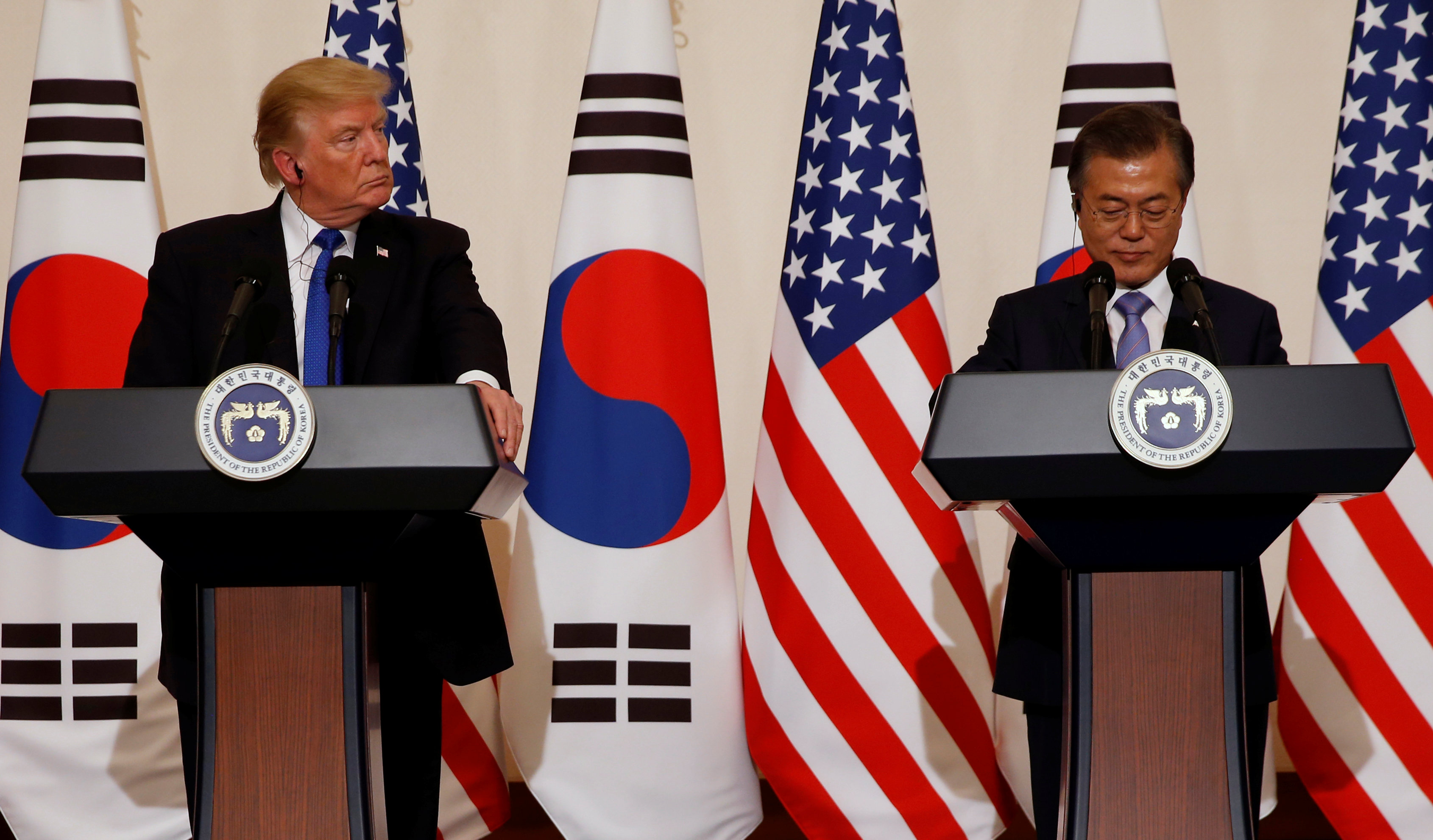 At North Korea's doorstep, Trump warns of U.S. power while also striking conciliatory note