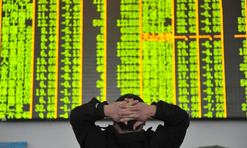 World stocks index dips after breaking record, oil near 2-1/2-year high